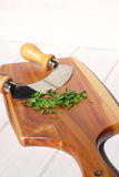 Chives chopped on wooden chopping board D Stock Images
