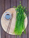 Chives flower, Garlic chives or Chinese Chive on a cutting board. Wooden background. Top view. Chives flower, Garlic chives or Chinese Chive on a cutting board royalty free stock photos