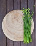 Chives flower, Garlic chives or Chinese Chive on a cutting board. Wooden background. Top view. Copy space. Chives flower, Garlic chives or Chinese Chive on a royalty free stock photography