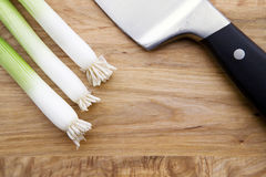 Chives and Knife on Cutting Board Royalty Free Stock Photos