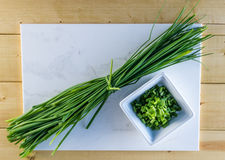 Chives on White Marble Stock Images