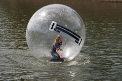 Chld insite a waterball Royalty Free Stock Photos