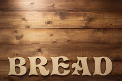 Chlebów listy na drewnianym tle Zdjęcia Royalty Free