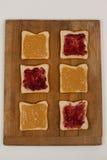 Chlebów plasterki z dżemem i masłem orzechowym Obraz Royalty Free