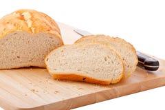 Chleb na ciapanie desce odizolowywającej na bielu zdjęcie stock