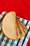 Chleb próżnuje na czerwieni, zieleń, biały tło Zdjęcie Stock