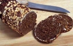 chlebowego noża pumpernikla plasterki Obrazy Stock