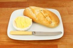 Chlebowej rolki nóż i masło obrazy stock