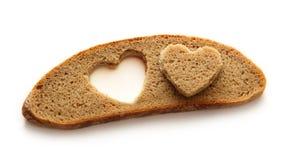 Chlebowy plasterek i serce Fotografia Royalty Free