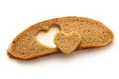 Chlebowy plasterek i serce Obrazy Royalty Free