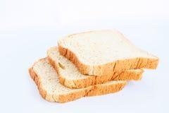 Chlebowy plasterek na bielu Fotografia Royalty Free
