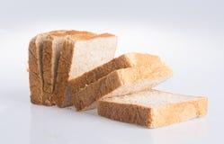Chlebowy plasterek na tle Obrazy Stock
