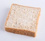 Chlebowy plasterek na tle Zdjęcie Royalty Free