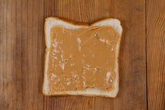 Chlebowy plasterek z masłem orzechowym Obrazy Royalty Free