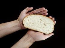 chlebowy ręk chwyta plasterek Fotografia Stock