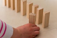 Chlid playing with Wood blocks. Wood blocks stack game using as background education concept Stock Image