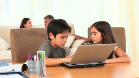 Chlidren playing on a laptop Stock Photography