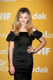 Chloe Grace Moretz arrives at the City of Hope's Music And Entertainment Industry Group Honors Bob Pittman Event Stock Photos