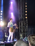 Chloe Howl at The Isle of Wight Festival. Chloe Howl singing in the Big Top at The Isle of Wight Festival in June 2104 Stock Photo