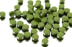 Chlorella (Algae). Pills on the white background Royalty Free Stock Images