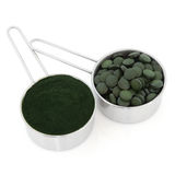 Chlorella Tablets and Powder Royalty Free Stock Photos