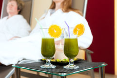 Wellness - Chlorophyll-Shake on a table. Chlorophyll-Shake in spa are on table, people are in Background Royalty Free Stock Photo