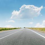 Chmura nad asfaltową drogą Zdjęcie Stock