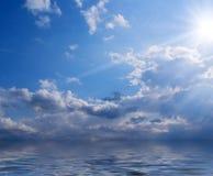 chmurnieje dennego słońce Obraz Stock