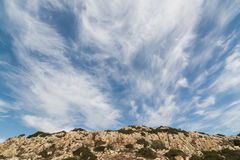 Chmurny niebo nad typowy Cypr krajobraz, Ayia Napa region Zdjęcia Stock