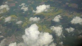 Chmury i ziemia Widok od płaskiego okno Fotografia Stock