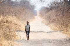 CHOBE, BOTSWANA - OCTOBER 5 2013: Poor African child wander thro Stock Images