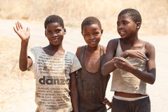 CHOBE, BOTSWANA - OCTOBER 5 2013: Poor African children wander t Royalty Free Stock Photo