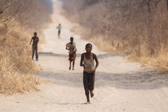 CHOBE, BOTSWANA - OCTOBER 5 2013: Poor African children wander t Royalty Free Stock Image