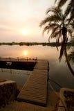 Chobe pier. A pier at sunset on the Chobe River, Botswana stock photos