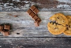 Choc chip cookie made to look like a popular arcade character, eating a chocolate chunk. stock photography