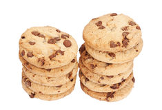 Choc Chip Cookies. Two stacks of chocolate chip biscuits isolated over a white background royalty free stock images