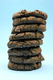 Choc Chip Cookies. Isolated against a blue background royalty free stock photography