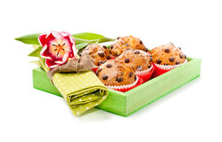 Choc chip muffins in a wooden tray Stock Image