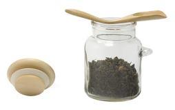 Choc en verre avec une cuillère en bois photo stock