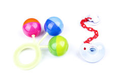 Chocalho colorido e chupeta do bebê Fotos de Stock Royalty Free