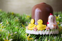 Chocholate bell  over flowerin garden Royalty Free Stock Image