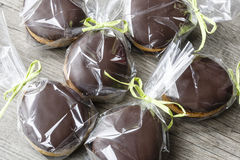 Chocholate and gingerbread easter eggs in plastic bags and green ribbon Royalty Free Stock Image