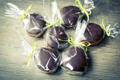 Chocholate and gingerbread easter eggs in plastic bags and green ribbon Stock Photography