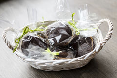 Chocholate and gingerbread easter eggs in plastic bags and green ribbon Stock Image
