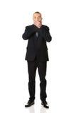 Chockad affärsman som täcker hans mun Arkivfoton