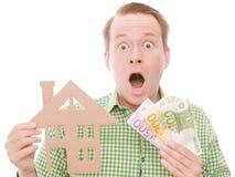 Chockad houseowner med pengar Royaltyfri Foto