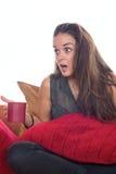 Chockad kvinna med kaffe arkivfoto
