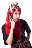 Chocked retro woman with red hair on the phone Stock Photo