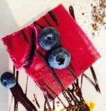Chockolat do gosto do bolo e rasberry celestiais imagem de stock