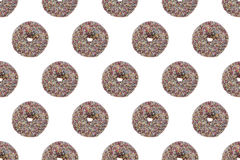 Chockolate的无缝的样式给油炸圈饼上釉 库存图片